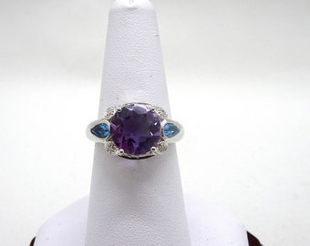 One Ladies 10kt Stamped White Gold Amethyst ,Diamonds and Topaz Ring