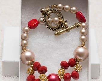 Pink pearl and rhinestone bracelet
