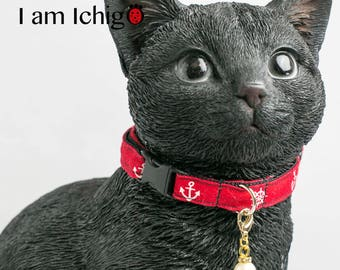 Red cat collar with a charm