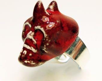 Ring with decoration of devil-skull ceramic.