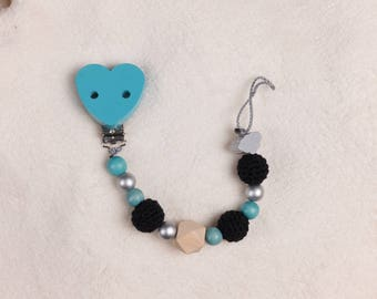 Pacifier Blue with a black clip and motif Pearl Cloud