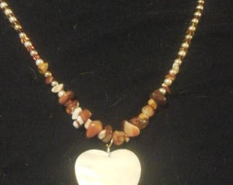 Banded agate with mother of pearl heart