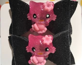 Beautiful foam bow with custom appliqué (glittery black with pink kitty) on an alligator clip. (Set of 2).