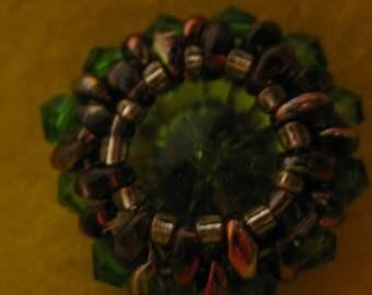 Netted green bezel rivoli pendant.