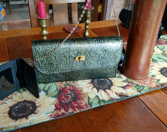 Olive Green Textured Leather bag with gold closure and removable strap