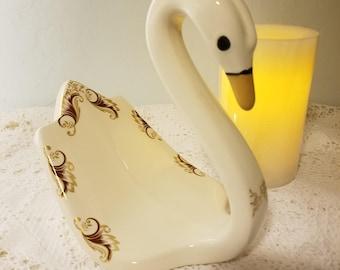 Porcelain swan towel holder