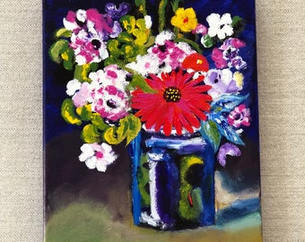 Assorted flowers in blue mason jar