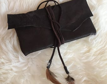Handmade leather bag/wallet wrap feather