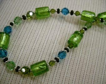 Noble Swarovski, lampwork glass beads, green, greenish, long, 925 sterling silver clasp, glitter, sparkle
