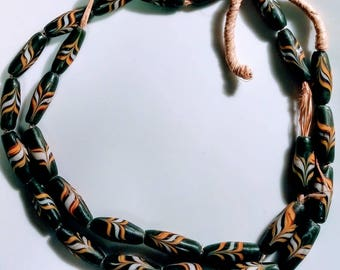 Green feather beads