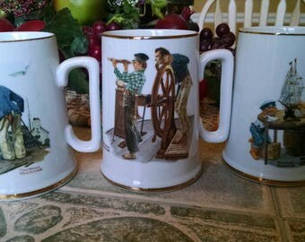 3 Norman Rockwell Mugs   20.00 1985 Looking out to the Sea,  River Pilot,  For a Good boy