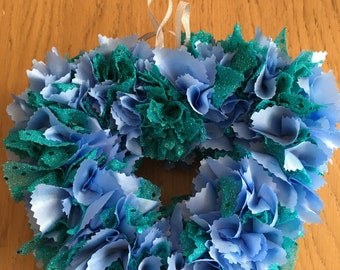 Beautiful blue and green silky fabric heart