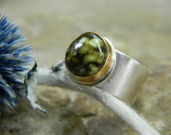 high grade damele turquoise ring - 14k gold filled bezel and wide sterling silver band. size 6.25
