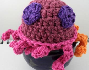 Crocheted Pinks, Oranges, and Purples Octopus Plush with Purple Eyes