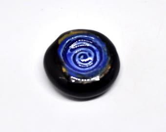 One big ceramic black and blue bead