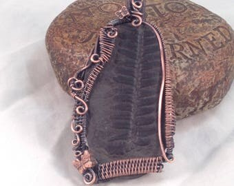Woven wire wrapped Fern Frond Fossil in copper, pendant