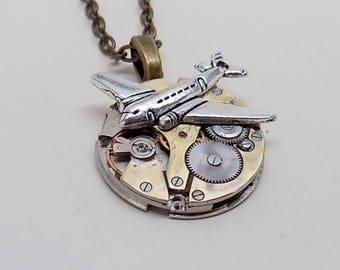 Steampunk jewelry. Steampunk watch with airplane pendant necklace.