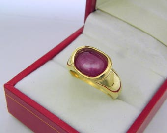 AAAA Natural Star Ruby  2.84 carats  10.7x7.7mm in 14K Yellow gold bezel set ring.  0257