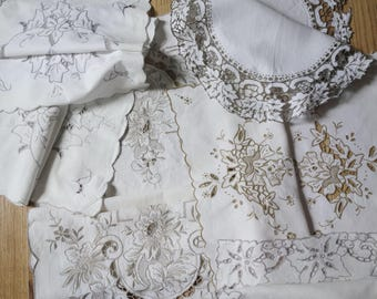 collection of vintage cutwork lace mats and runner
