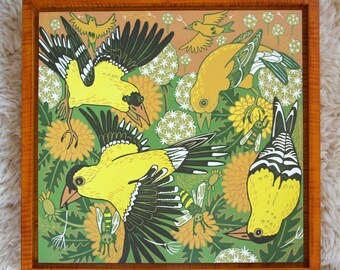 Goldfinch, colorful wall art, woodcut, framed in yellow curly maple, printmaking