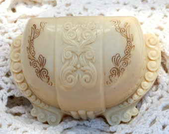 vintage 1930's celluloid jewelry trinket box - hinged and etched with relief design
