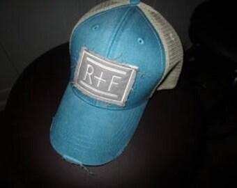 Rodan and Fields Patch Trucker Hat