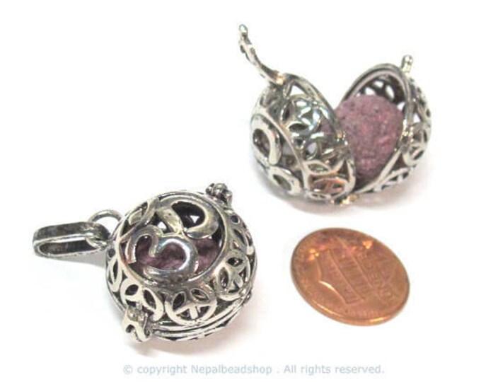 1 pendant - Tibetan om with peace symbol cage diffuser pendant with 1 lava bead - PM572