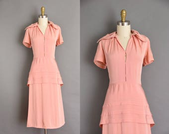 Pink rayon vintage 1940s dress with peek a boo cut outs