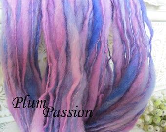 Thick and thin wool art yarn hand spun chunky bulky in soft lilac plum deep blue purple mauve