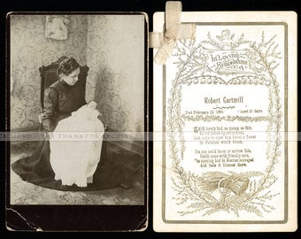 woman in mourning dress holding post mortem baby + his memorial funeral card
