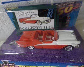 Die Cast Fabulous 50s Starfire Oldsmobile with Authentic 50s Billboard, new in package, 1996. 1/43 Scale.
