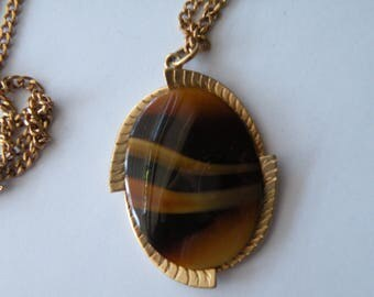 "Sarah Coventry brown glass pendant, "" Caramel tone ""."