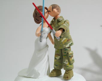 Soldier theme wedding cake topper - Star Wars light saver