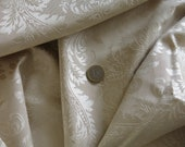 Ivory / off-white brocade coupon fabric