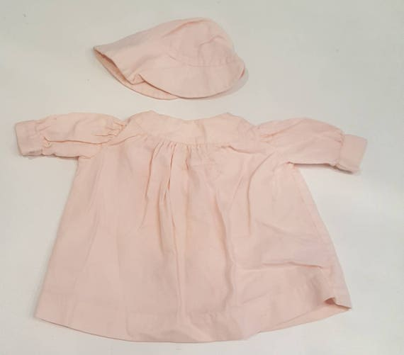 Vintage pink dress and bonnet baby outfit