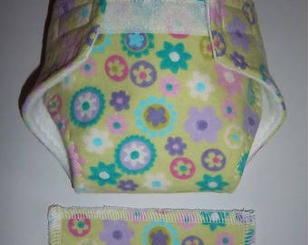 Baby Doll Diaper/wipe - pretty multi color and multi size geo flowers on apple green, Size M - adjustable for many dolls such as bitty baby