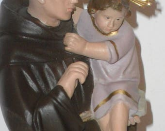 Antique image of Saint  Anthoni of Padua with the infant Jesus, of the 40 former Catholic religious statue with glass eyes.