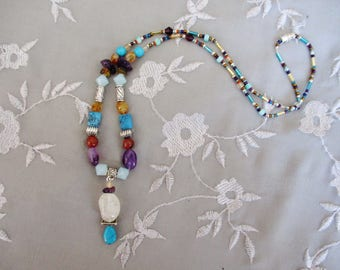 Colorful gemstone necklace with a citrine pendant and turquoise amethyst and jasper
