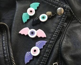 Eye with bat wings Pin