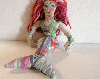 Rainbow non-binary NB merperson original art doll tribal style primitive tattoos colorful stim toy fidget beanbag