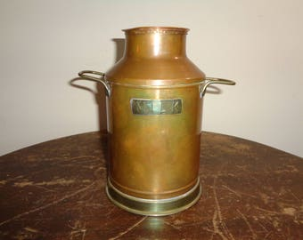 Vintage Copper Milk Vessel with wonderful well developed patina with solid brass handles, base and nameplate in Good Condition