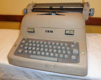 "Vintage IBM Model  IIC 1955  Electric Typewriter in Working Condition that is a strong, sturdy and very heavy machine Sold ""As Is"""
