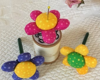 Spool Pin Cushion. This Listing is For One Spool Pin Cushion, Pink Petals With Yellow,Yellow Petals With Green, Purple Petals With Yellow.