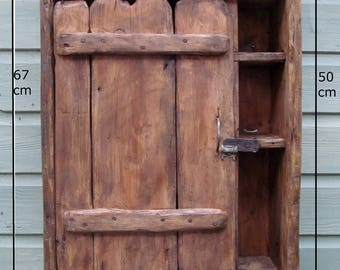 Rustic/driftwood style cabinet and in recycled pine with medium dark wax finish