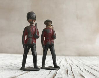 1930s Britain's die-cast lead soldiers. Two well loved and play worn figures, but still adorable. Made in England.