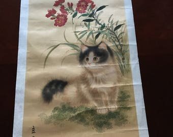 Asian painting on silk of cat and flowers.