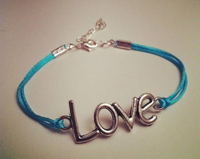 Turquoise cord bracelet with LOVE silver