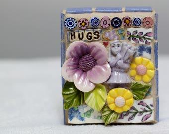 HUGS mosaic, pique assiette, mosaic art
