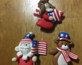 Three piece pin set patriotic santa angel and teddy with stars and stripes red white blue flag