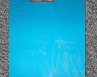 On Sale 100 Teal Blue 9x12 Retail Merchandise Gift Bags With Cut Out Handles, Low density Wholesale lot of Premium Plastic Bags